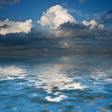 Beautiful syk reflected in calm sea waters Stock Photography