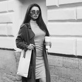 Beautiful syulish woman walking at city street Royalty Free Stock Photography