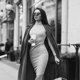 Beautiful syulish woman walking at city street Stock Photo