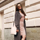 Beautiful syulish woman walking at city street Stock Photos