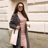 Beautiful syulish woman walking at city street Royalty Free Stock Image
