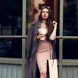 Beautiful syulish woman walking at city street Stock Images