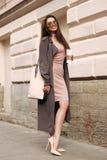 Beautiful syulish woman walking at city street Stock Photography