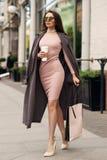 Beautiful syulish woman walking at city street Royalty Free Stock Images