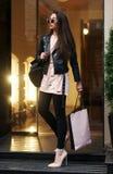 Beautiful syulish woman walking at city street Stock Image