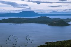 Beautiful Taal Volcano and Lake in Tagaytay, Philippines. Beautiful Taal Volcano and Lake in Tagaytay City, Philippines while sun is rising Royalty Free Stock Photography