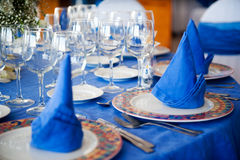 Beautiful table with blue napkins Stock Photo