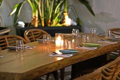 Beautiful table set in an elegant restaurant of Chora in Mykonos. Greece royalty free stock photography