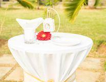 Beautiful table set fot wedding. Beautiful elegant white table set for wedding or event party on table red flower, outdoor Stock Photo