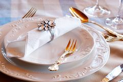 Beautiful table setting. Table setting with golden cutlery and crystal glasses Stock Photos