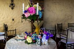 Beautiful Wedding Flower Arrangement Table Setting with candles royalty free stock photography