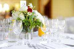 Beautiful table setting with crockery and flowers for a party, wedding reception or other festive event Stock Photography