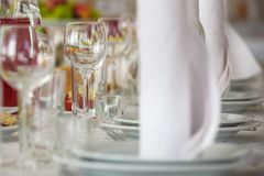 Beautiful table setting with crockery and flowers for a party, wedding reception or other festive event. Glassware and cutlery for. Catered event dinner Royalty Free Stock Photo