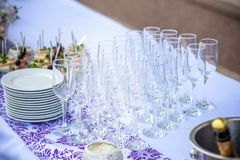 Beautiful table setting with crockery and flowers for a party, wedding reception or other festive event. Glassware and cutlery for catered event dinner Stock Image