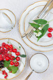 Beautiful table setting  with different berries Stock Images