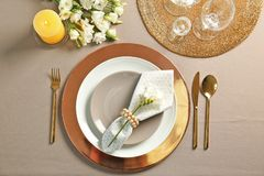 Beautiful table setting with flatware. Beautiful table setting with golden flatware stock photos