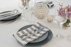 Beautiful table setting for an occasion. Close-up of beautiful table setting for an occasion Stock Images