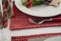 Beautiful table setting for an occasion. Close-up of beautiful table setting for an occasion Royalty Free Stock Image