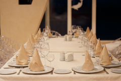 Beautiful table setting. Serving of glasses and napkins on the table royalty free stock photo