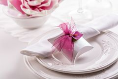 Beautiful table setting with small present stock photos