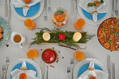 Beautiful table setting with tangerines. On wooden table stock photography