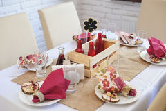 Beautiful table setting wedding table in a restaurant in the rustic style Royalty Free Stock Photo