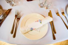 Beautiful table setting on white background. Space for text royalty free stock photo