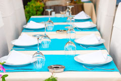 Beautiful tables with kitchenware Royalty Free Stock Images