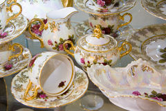 Beautiful  tableware with painted roses Stock Image