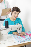 Beautiful Tailor Using Sewing Machine At Factory Royalty Free Stock Photography