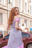 Beautiful and tall girl model appearance in stylish clothes walking around the city Royalty Free Stock Images