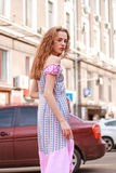 Beautiful and tall girl model appearance in stylish clothes walking around the city Stock Photos