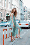 Beautiful and tall girl model appearance in stylish clothes walking around the city Royalty Free Stock Photography