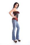 Beautiful tall model in jeans and sexy corset Stock Photo