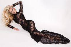 Beautiful tall slim blonde with amazing body dressed in an elegant dress lace dress Royalty Free Stock Image