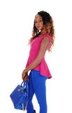 Beautiful tall woman with blue purse. Stock Image