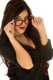 Beautiful tan brunette female model confident funky glasses Royalty Free Stock Images