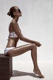 Beautiful tan female model posing Stock Photos