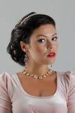 Beautiful tan woman posing. In pink dress Royalty Free Stock Image
