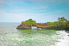 Beautiful Tanah lot temple on beach cliff Royalty Free Stock Photography