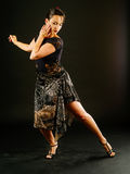 Beautiful tango dancer. Photo of a young beautiful woman performing tango moves Royalty Free Stock Images