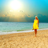 Beautiful tanned blonde girl on the sea Stock Photography