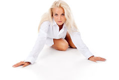Beautiful tanned blonde posing lying on the floor Royalty Free Stock Photo