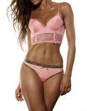 Beautiful tanned sexy young woman in lingerie, pink corset and p Royalty Free Stock Images