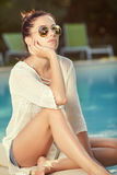 Beautiful tanned sporty slim woman relaxing in swimm Royalty Free Stock Images