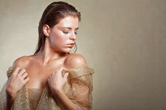Beautiful tanned woman in gold dress Royalty Free Stock Images