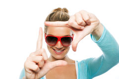 Beautiful tanned woman making a frame gesture Stock Image