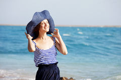 Beautiful  tanned woman resting on the beach in summer day Royalty Free Stock Image