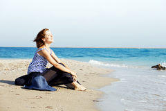 Beautiful  tanned woman resting on the beach in summer day Royalty Free Stock Images