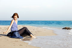 Beautiful  tanned woman resting on the beach in summer day Stock Photography